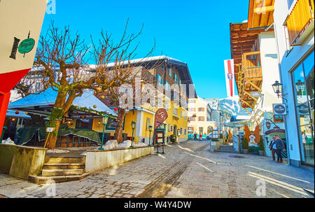 ZELL AM SEE, AUSTRIA - FEBRUARY 28, 2019: The old street of popular mountain resort with colorful edifices, cafes, restaurants, sport stores and souve - Stock Photo
