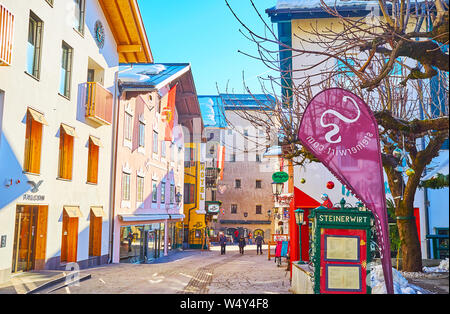 ZELL AM SEE, AUSTRIA - FEBRUARY 28, 2019: The quiet morning street of popular mountain resort with traditional architecture, souvenir stores and cafes - Stock Photo