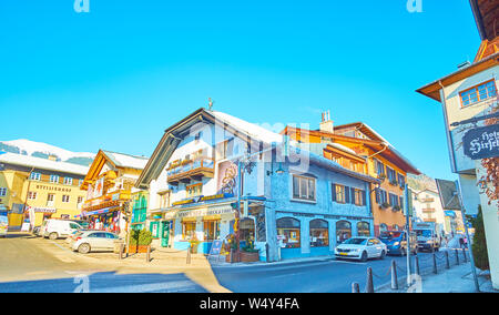 ZELL AM SEE, AUSTRIA - FEBRUARY 28, 2019: The old quarter of resort with stores, restaurants, art galleries, travel agencies and sport shops, located - Stock Photo