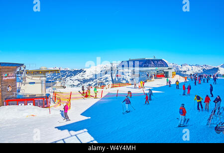 ZELL AM SEE, AUSTRIA - FEBRUARY 28, 2019: The skiers and boarders arrived to the top of Schmitten mountain on the ski lifts, covering its slopes, on F - Stock Photo