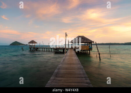 Wooden bar in sea and hut with dramatic sunset sky in Koh Mak at Trat, Thailand. Summer, Travel, Vacation and Holiday concept. - Stock Photo