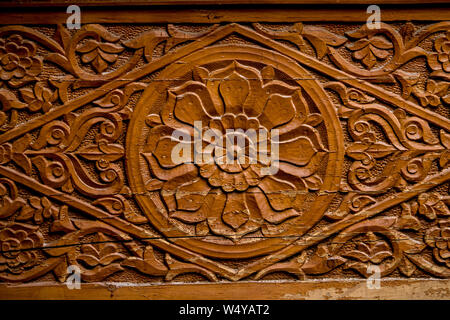 Beautifully carved wooden pillars and wooden patterns in himalayan palaces - Stock Photo