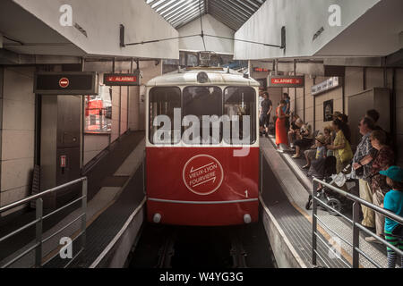 LYON, FRANCE - JULY 19, 2019: Lyon Funicular Railway entering the station of Old Lyon with tourists preparing to enter, before bringing them to Fourvi - Stock Photo