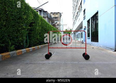 Closeup of stop sign standing on street, safety concept - Stock Photo