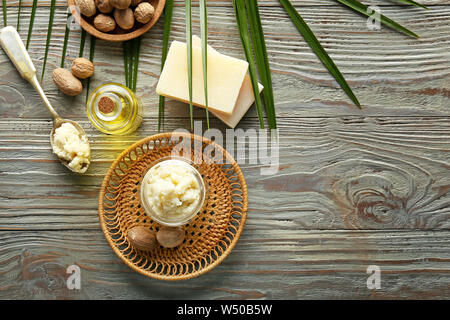 Composition with shea butter on wooden background - Stock Photo