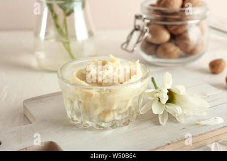 Bowl with shea butter on table - Stock Photo