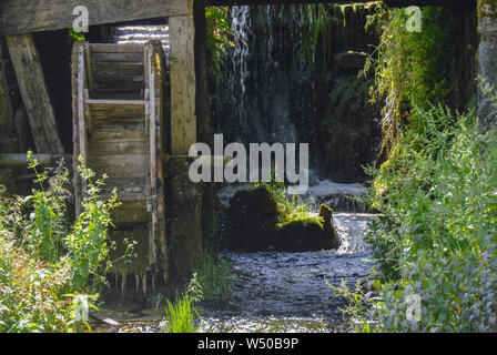 Old wooden mill wheel on river Gacka springs - Stock Photo