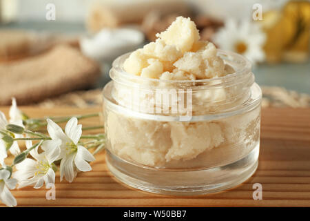 Jar with shea butter on table - Stock Photo