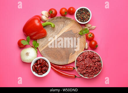 Ingredients for chili con carne with plate on color background - Stock Photo