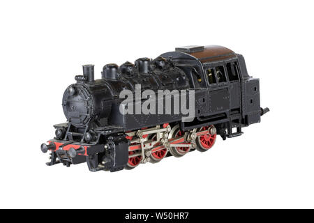 Locomotive isolated. Vintage model of an electric toy steam train isolated on a white background. Decorations background. - Stock Photo