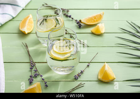 Glasses with lavender lemonade on wooden table - Stock Photo