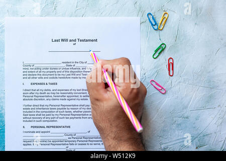 Person Filling Blank Last Will and Testament Form. Top view Stock Photo