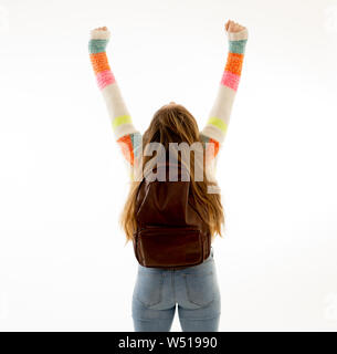 Back view portrait of happy and cheerful teenager girl celebrating vacations, success, getting into university or student lifestyle isolated on white - Stock Photo