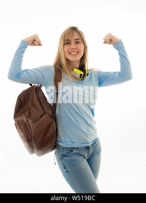 Portrait of pretty teenager student young woman showing her muscles arms posing joyful and cheerful feeling proud, strong and successful. Isolated on - Stock Photo