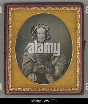 Portrait of an elderly woman wearing a hat, fur coat and gloves, seated, Unknown maker, American, about 1855, Daguerreotype - Stock Photo
