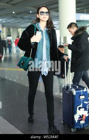 Chinese model and actress Zhang Zilin is pictured at the Beijing Capital International Airport in Beijing, China, 17 January 2019. - Stock Photo