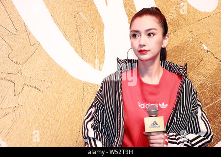 Hong Kong actress Angelababy attends a promotional event for Adidas in Shanghai, China, 11 January 2019. - Stock Photo