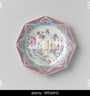 Octagonal plate with two deer near rocks and flowering plants, Octagonal plate of porcelain, painted on the glaze in blue, red, pink, green, yellow, purple and black. On the flat two deer near rocks and flowering plants and mushrooms (lingzhi), the border with eight half-scalloped cartouches with a flower on napkin work, in between eight stylized lotus vines against a blue ground. Plate has been broken. Famille rose., anonymous, China, c. 1725 - c. 1749, Qing-dynasty (1644-1912) / Yongzheng-period (1723-1735) / Qianlong-period (1736-1795), porcelain (material), glaze, gold (metal - Stock Photo