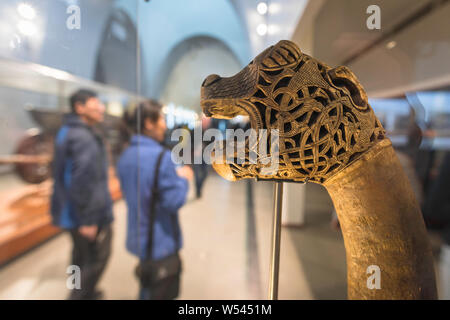 Viking Museum Oslo, view of an intricately carved wooden animal head post  discovered in the Oseberg ship, Viking Ship Museum, Oslo, Norway. - Stock Photo