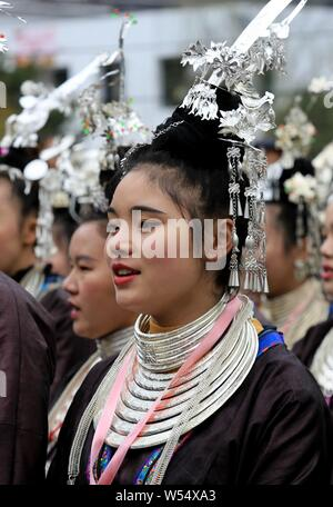 Local Chinese girls and women of Dong ethnic minority, dressed in traditional costume, attend a celebration to mark the Chinese Lunar New Year, also k - Stock Photo