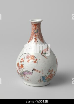 Pear-shaped bottle vase with three groups of flowers and three birds, Bottle-shaped porcelain vase with a pear-shaped body and spreading neck, painted on the glaze in blue, red, green, yellow, black and gold. On the belly three flower groups (peony, chrysanthemum) with bamboo, a rock or hedges tied together with a flying bird and a bird on a branch (hoo-birds [?]) Or a standing bird (crane [?]). On the neck a band with napkin work in lambrequins, separated by a flower and hanging tendrils. Baking sand on the foot ring. The edge has been broken. Old label on the bottom with 'Collectie - Stock Photo