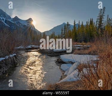 Sun Setting behind Ha Ling Peak in Canmore, Alberta, Canada - Stock Photo