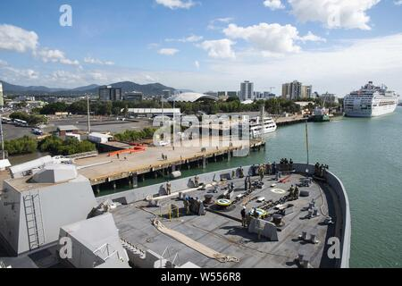190726-N-DX072-1059 CAIRNS, Australia (July 26, 2019) The amphibious transport dock ship USS Green Bay (LPD 20) arrives in Cairns, Australia for a scheduled port visit, July 26, 2019. Green Bay, part of the Wasp Expeditionary Strike Group, with embarked 31st Marine Expeditionary Unit, participated in Talisman Sabre 2019 off the coast of Northern Australia. A bilateral, biennial event, Talisman Sabre is designed to improve U.S. and Australian combat training, readiness and interoperability through realistic, relevant training necessary to maintain regional security, peace and stability. (U.S. N - Stock Photo