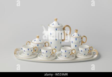 Coffee service with flowers, Porcelain coffee set, painted on the glaze in blue, red, green and gold. The service consists of twelve parts, including a tray, coffee pot, milk jug, sugar bowl and four cups with saucers. All decorated with blue flowers. Marked on the bottom with the crossed hammers with crown., Pirkenhammer, Karlovy Vary, c. 1935, porcelain (material), glaze, gold (metal), vitrification - Stock Photo