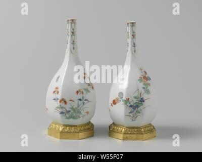 Bottle, multicolored painted with a Kakiemon decor, Octagonal bottle of painted porcelain and a gilt bronze frame. The vase has a slender neck and is painted on both sides with flowering plants in kakiemon style. The vase is marked., Meissener Porzellan Manufaktur, Meissen, c. 1730, porcelain (material), h 22.5 cm h 27.0 cm d 11.5 cm - Stock Photo