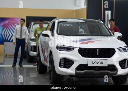 --FILE--A WEY VV5 SUV is for sale at a dealership store of WEY of Great Wall Motors in Guangzhou city, south China's Guangdong province, 2 July 2018. - Stock Photo