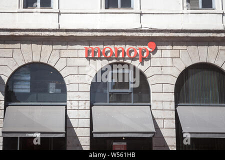 LYON, FRANCE - JULY 19, 2019: Monop logo, the other name of Monoprix, in front of their local supermarket. Monoprix is a French chain of convenience s - Stock Photo
