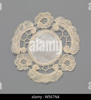 Dress or doily from bobbin lace with c-volute and rosette flower, Dress or doily from natural-colored bobbin lace: Bruges floral arrangement. Round model with round center piece of batiste. The repeating pattern consists alternately of a c-volute and rosette flower. The motifs are made in net and linen with openwork edges. The motifs are accentuated by contour threads. A decorative soil is used in the flower hearts, a closed pin-striking soil. Between the motifs some connections have been made with double braids with picots, which form three-pointed stars. The scallop edge comes from - Stock Photo