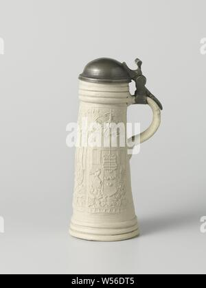 Tankard (schnelle) with the coat of arms of Cologne-Paderborn, Jug (schnelle) of stoneware with cylindrical, tapered body and C-shaped ear. Profiles below the edge and above the foot. On the body in relief three times a printed and imposed elongated box with the arms of Cologne-Paderborn and the heart shield of the Counts of Isenburg. Above the coat of arms the date '1576' and in each box the mark 'L.W.'. The jug is set in a pewter frame with lid. Siegburg, armorial bearing, heraldry, Monogrammist LW, Siegburg, c. 1576 - c. 1590, stoneware, glaze, montuur, vitrification, h 36.5 cm - Stock Photo