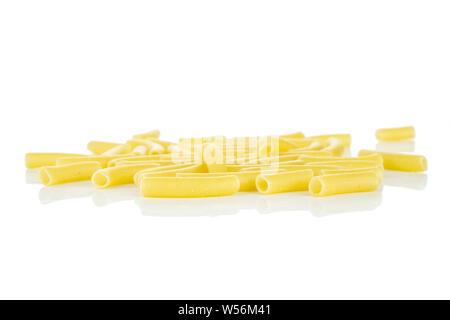 Lot of whole raw pasta macaroni isolated on white background - Stock Photo