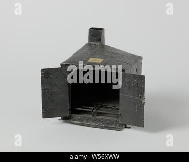 Model of a Ship's Galley, Model of a galley for the main deck, painted black. It is a simple cube with iron walls, standing on legs that have a hole to be screwed into the deck. The galley has double doors with a slide and lock. The floor has two levels, slightly higher at the rear than at the front, on the front is a grid with movable irons. The roof is sloping with a chimney behind. Inside, hooks are attached to the walls on which chains can be hung., anonymous, Netherlands, c. 1780, iron (metal), paint (coating), h 33.2 cm × w 29.5 cm × d 28 cm - Stock Photo