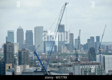 London, UK. 26th July, 2019. UK Weather : A general view of East London and Canary Wharf as seen from the free public garden at 120 Fenchurch Street in the City of London during warm weather. Situated on the 15th floor, the outdoor garden affords visitors a 360 degree view of the capital, nearby iconic landmarks, such as The Walkie Talkie and Gherkin, and also includes a water feature and flower garden which attracts bees and other pollinators. Credit: Stephen Chung/Alamy Live News - Stock Photo