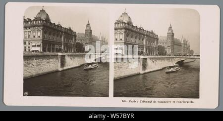 View of the bank along the Seine in Paris, with the Conciergerie Paris in the background: Tribunal de Commerce and Conciergerie (title on object), facade (or house or building), bridge, river, Conciergerie, Neue Photographische Gesellschaft (mentioned on object), Paris, in or after 1895 - c. 1905, cardboard, photographic paper, gelatin silver print, h 88 mm × w 179 mm - Stock Photo