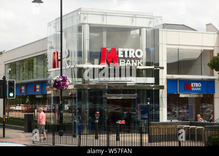 A high street branch of the Metro Bank / Metrobank bank. Two Rivers Shopping Centre. Staines-upon-Thames, Surrey, England. UK (111) - Stock Photo