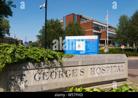 Outside front exterior of Saint Georges Hospital in Tooting, London. UK. Saint Georges in tooting is the main hospital of St George's University Hospitals NHS Foundation Trust. (111) - Stock Photo