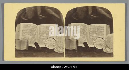 Still life with bible, Book of Common Prayer and magnifying glass, still life of miscellaneous objects, Bible, magnifying glass, anonymous, c. 1855 - c. 1870, photographic paper, cardboard, albumen print, h 84 mm × w 174 mm - Stock Photo