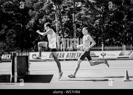 Chelyabinsk, Russia - July 12, 2019: male athlete running 3000 meters with obstacles steeplechase  during Championship in athletics in memory of Georg - Stock Photo