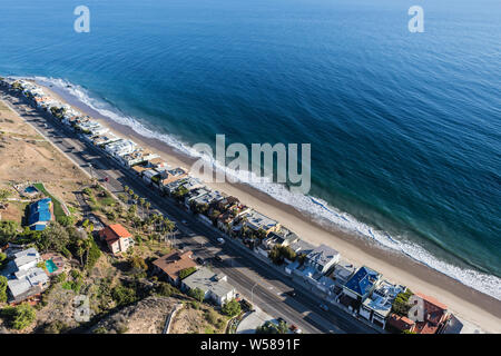 Aerial view of beaches and homes along Pacific Coast Highway north of Santa Monica and Los Angeles in scenic Malibu California. - Stock Photo