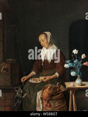 Woman Eating, Known as 'The Cat's Breakfast' Woman at the meal, known as 'The cat's breakfast', A sitting woman eats a herring with bread, a cat jumping up against her gets the bone the fish. Performance known as 'The cat's breakfast'. On the left a water pump, in the foreground a barrel with a dead chicken, on the right a vase with flowers on a table, breakfast, cat (feeding animal), fishes, flowers in a vase, Gabriel Metsu, c. 1661 - c. 1664, panel, oil paint (paint), h 34 cm × w 27 cm d 6 cm - Stock Photo