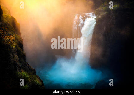 Sunrise at the Victoria falls on the Zambezi River, Zimbabwe, Zambia - Stock Photo