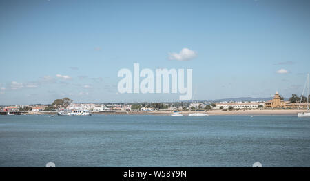Tavira, Portugal - May 3, 2018: View of the lagoons of the Ria Formosa Natural Park near the port of Tavira where fishing and tourist boats are statio - Stock Photo