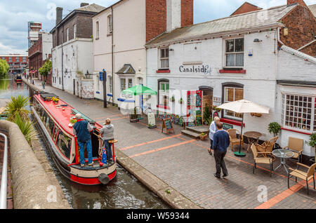 Narrow Boats at Gas Street Basin, a canal basin in the centre of Birmingham, England, where the Worcester and Birmingham Canal meets the BCN Main Line - Stock Photo