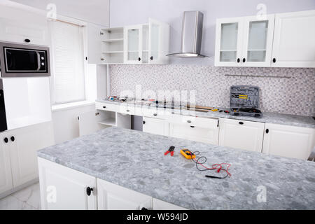 Close-up Of An Electrical Kitchen Induction Ceramic Hob In Kitchen With Tools - Stock Photo