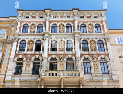 TRIESTE, Italy - June 16, 2019: Richly decorated exterior facade of an elegant historic building in Carducci street