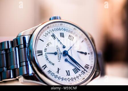 Lodz, Poland, Apr 2019 Longines hand watch, macro, luxury watch company, Longines winged hourglass logo registered 1889 is oldest unchanged trademark - Stock Photo