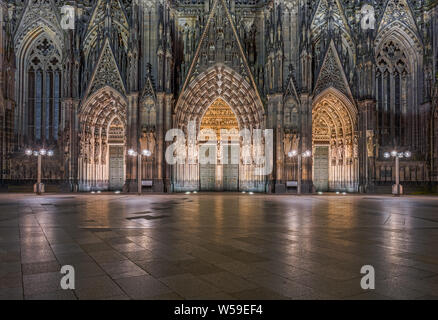 Cologne Cathedral Entrance at Night - Stock Photo